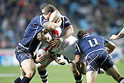 Scotland surround England's Thomas Burgess (14 South Sydney Rabbitohs) during the Ladbrokes Four Nations match between England and Scotland at the Ricoh Arena, Coventry, England on 5 November 2016. Photo by Craig Galloway.