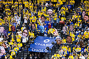 Golden State Warriors fans hold giant face cutouts as the Cleveland Cavaliers shoot a free throw during Game 1 of the NBA Finals at Oracle Arena in Oakland, Calif., on May 31, 2018. (Stan Olszewski/Special to S.F. Examiner)