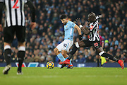 Mohamed Diame & Sergio Aguero during the Premier League match between Manchester City and Newcastle United at the Etihad Stadium, Manchester, England on 20 January 2018. Photo by George Franks.