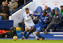Leicester City's Danny Simpson and Wilfred Ndidi (right) tackle Crystal Palace's Ruben Loftus-Cheek during the Premier League match at the King Power Stadium, Leicester.