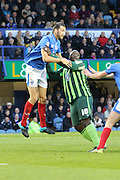 Bayo Akinfenwa of AFC Wimbledon and Christian Burgess during the Sky Bet League 2 match between Portsmouth and AFC Wimbledon at Fratton Park, Portsmouth, England on 15 November 2015. Photo by Stuart Butcher.
