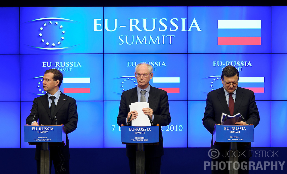 "Dmitry Medvedev, Russia's president, left, Herman Van Rompuy, president of the European Council, center, and Jose Manuel, Barroso, president of the European Commission, hold a joint press conference following the EU-Russia summit at the European Union council headquarters in Brussels, Belgium, on Tuesday, Dec. 7, 2010. Russia will move a step closer to membership in the World Trade Organisation today when it signs an agreement with the European Union settling ""key questions"" that have hampered its accession bid for years. (Photo © Jock Fistick)."