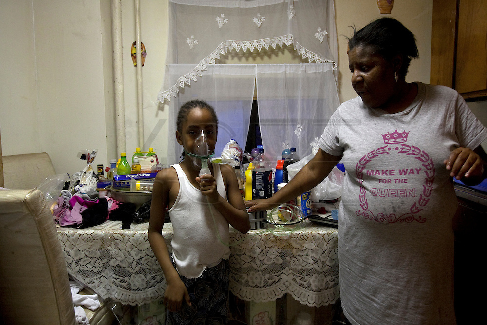 Marcio, 8 years old and his mother Ruby Collins. Marcio suffers from asthma and he needs to use the bomb everyday due to infiltrations in his apartment. They live on the Projects in the Bronx, New York. <br /> Public housing in New York were built by NYCHA (New York City Housing Authority) using low cost materials and due to that, the houses get mold, infiltrations and other problems. Living with this environment leads to health diseases such as asthma and other respiratory allergies. As they are public houses, people wait for 2 years to get their houses fixed and as time goes by, the exposure to these fungus leads to an intolerant public health situation. The public houses  are scattered in the city: lower Manhatthan, harlem and the bronx. However, in the Bronx, the situation is a severe issue where the asthma death rate is one of the highest in the city. Living in these houses is living side by side with a &quot;silent murder&quot;.