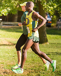 Boston College Invitational Cross Country race at Franklin Park; Ed Cheserek warms down with coach Maurica Powell