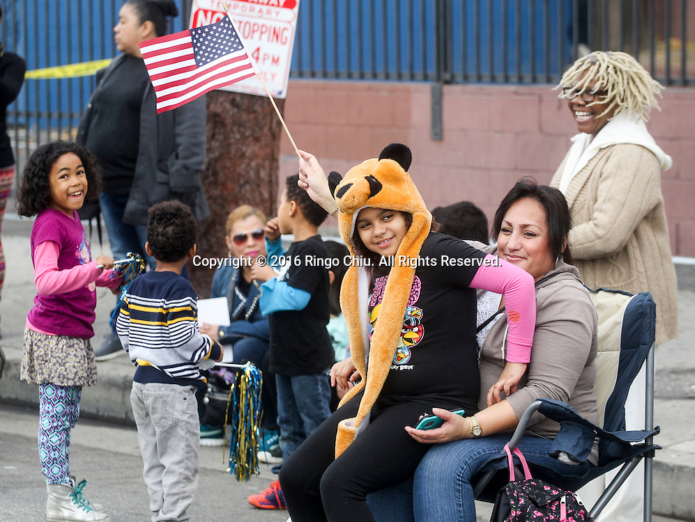 Spectators watch as the Martin Luther King Jr. parade makes it's way down Martin Luther King Blvd. in Los Angeles on Monday Jan. 18, 2016. The 31st annual Kingdom Day Parade honoring Martin Luther King Jr. was themed &quot;Our Work Is Not Yet Done&quot;(Photo by Ringo Chiu/PHOTOFORMULA.com)<br /> <br /> Usage Notes: This content is intended for editorial use only. For other uses, additional clearances may be required.