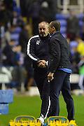 handshake between Everton's manager Roberto Martinez and Reading's Manager Steve Clarke at end of the Capital One Cup match between Reading and Everton at the Madejski Stadium, Reading, England on 22 September 2015. Photo by Mark Davies.
