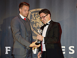 CARDIFF, WALES - Tuesday, November 8, 2016: Wales' Chris Gunter is awarded the Media Choice award from Wales Online's Chris Wathan during the FAW Awards Dinner at the Vale Resort. (Pic by David Rawcliffe/Propaganda)