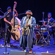 WASHINGTON, DC - August 26, 2015 - Miles Mosely, Ronald Bruner and Kamasi Washington perform at the Howard Theatre in Washington, D.C. After working with artists such as Kendrick Lamar and Flying Lotus, Washington is touring behind his debut studio album, The Epic.  (Photo by Kyle Gustafson / For The Washington Post)