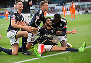 August 9th 2017, Dens Park, Dundee, Scotland; Scottish League Cup Second Round; Dundee versus Dundee United; A soft drink thrown from the Dundee United fans doesn't dampen Dundee's Faissal El Bakhtaoui celebrations after he had scored to put his side 1-0 ahead in the Dundee derby