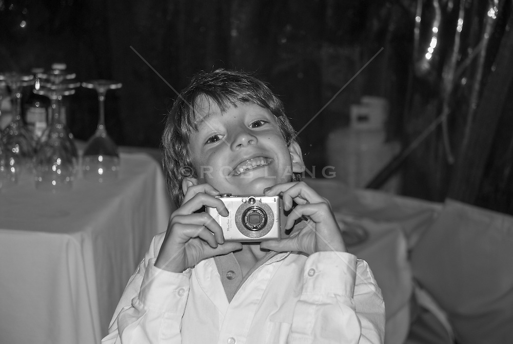 little boy with a camera a a wedding