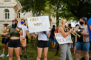 23 JULY 2020 - DES MOINES, IOWA:  Black Lives Matter protesters play musical instruments and bang pots and pans during a noise making protest at the Polk County Criminal Court. About 75 members of Des Moines Black Lives Matter protested in support of Viet Tran, one of their members who was arrested by Des Moines Police on July 1. He was arrested on charges of disseminating classified or confidential police information because during an interview with a local TV station, he held a memo from the Des Moines Police Department naming individuals police wanted to arrest on vandalism charges. He got the memo from another Black Lives Matter protester. During today's bond hearing the court ruled that Tran should be released and subjected to electronic monitoring before the weekend.       PHOTO BY JACK KURTZ