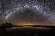 A 30x45-inch panoramic print of a beautiful Milky Way arching over the Aurora Australis.  Waituna Lagoon, New Zealand