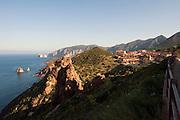 Sardegna, Italy. Costa occidentale, Iglesiente, Nébida e sullo sfondo il faraglione calcareo denominato Pan di zucchero.
