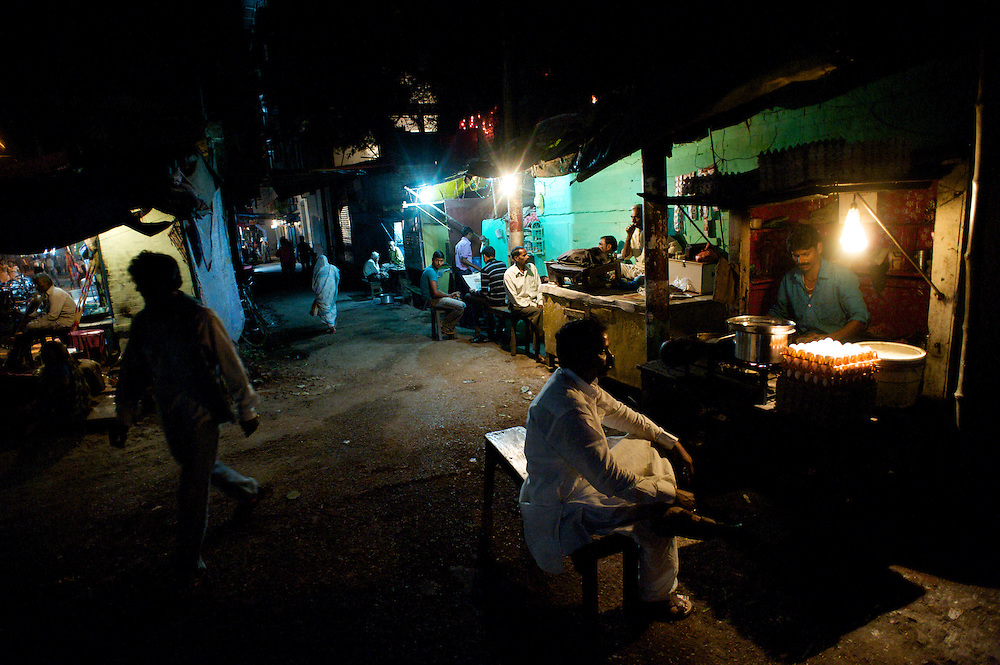 There is a lot of life to be seen walking the streets of Varanasi at night. In this image vendors sell food, mean sit and talk, and the town is still vibrant into the late hours.