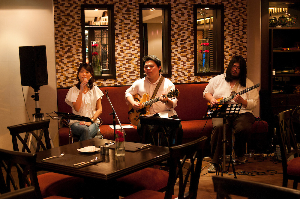 Live entertainment at World famous chef, Ken Hom's restaurant Maison Chin in Bangkok, Thailand.