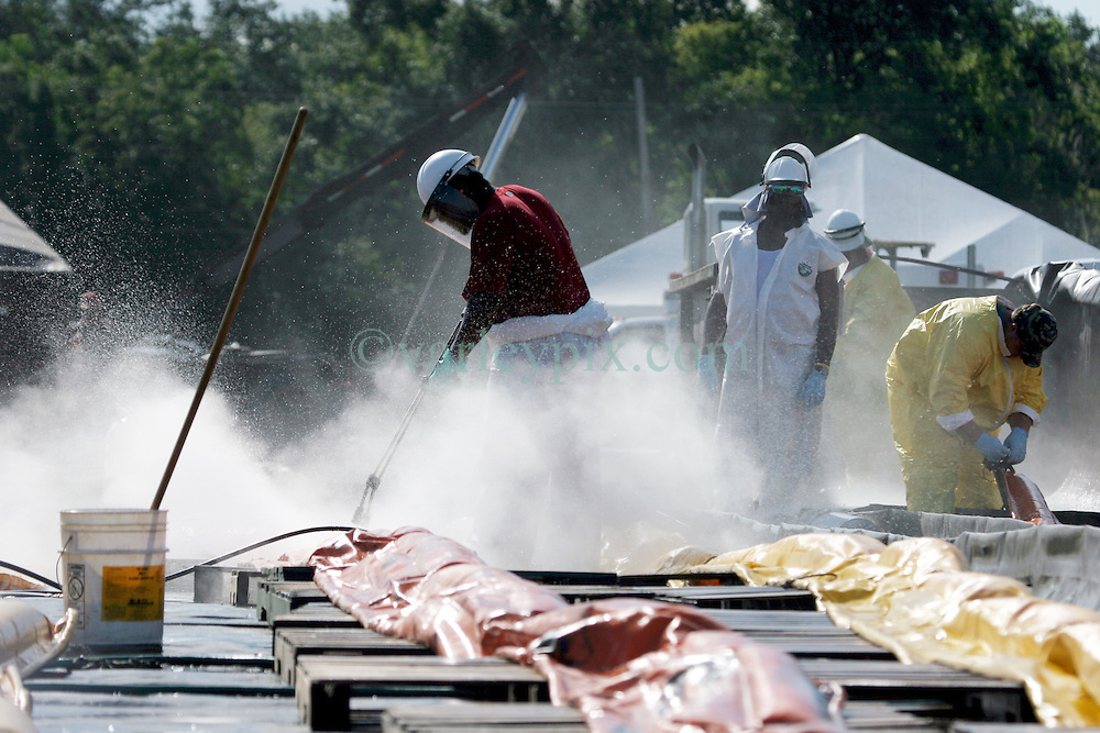 21 August 2010. Jean Lafitte, Louisiana. <br /> Contractors for BP decontaminate and clean ocean oil booms before they are returned to service as the worst environmental disaster in US history continues to unfold in south Louisiana.<br /> Photo credit; Charlie Varley/varleypix.com