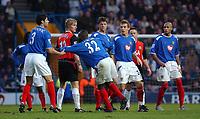 Fotball<br /> England 2004/22005<br /> Foto: SBI/Digitalsport<br /> NORWAY ONLY<br /> <br /> Portsmouth v Blackburn Rovers<br /> 15/1/2005<br /> Barclays Premiership<br /> <br /> Portsmouth's Dejan Stefanovic drags Lua Lua off the picth after the striker was sent off.