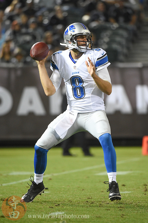 August 15, 2014; Oakland, CA, USA; Detroit Lions quarterback Dan Orlovsky (8) passes the football against the Oakland Raiders during the second quarter at O.co Coliseum.