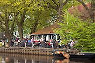 Europe, Germany, Lower Saxony, Worpswede, terrace of the restaurant Hammehuette at the river Hamme at Neu Helgoland,Teufelsmoor.<br /> <br /> Europa, Deutschland, Niedersachsen, Worpswede, Terrasse der Gaststaette Hammehuette an der Hamme bei Neu Helgoland, Teufelsmoor.