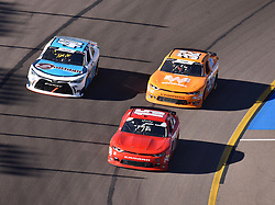 November 10, 2018 - Phoenix, Arizona, U.S. - PHOENIX, AZ - NOVEMBER 10:  Quin Houff (15) Chevrolet leads  Chad Finchum (40) Chevrolet and David Starr (52) Whataburger Chevrolet into the turn at the NASCAR Xfinity Series Playoff Race - Whelen 200  on November 10, 2018 at ISM Raceway in Phoenix, AZ.  (Photo by Lyle Setter/Icon Sportswire) (Credit Image: © Lyle Setter/Icon SMI via ZUMA Press)