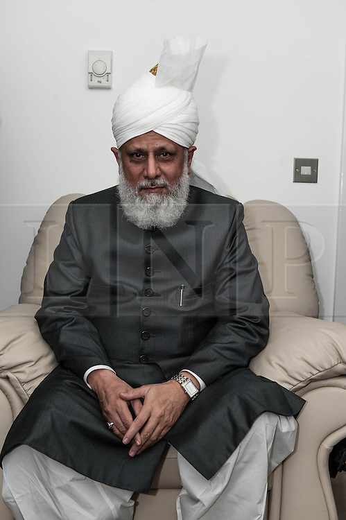 © Licensed to London News Pictures. 21/09/2012. London,UK.  His Holiness Hadhrat Mirza Masrror Ahmad shortly after having given a sermon at the Baitul Futuh Mosque in Morden, London, in the wake of  protests across the Islamic world against the film 'Innocence of Muslims'.  His Holiness Hadhrat Mirza Masrror Ahmad is the Khalifa and worldwide muslim leader for Islam.   The Baitul Futuh Mosque is the largest mosque in Europe.  Photo credit : Richard Isaac/LNP