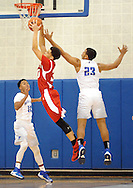 Bristol's Dayeshawn Cortez (30) and Bensalem's Josh Hill (23) go for a rebound in the first quarter Tuesday December 27, 2016 at Bensalem High School in Bensalem, Pennsylvania. (Photo by William Thomas Cain)