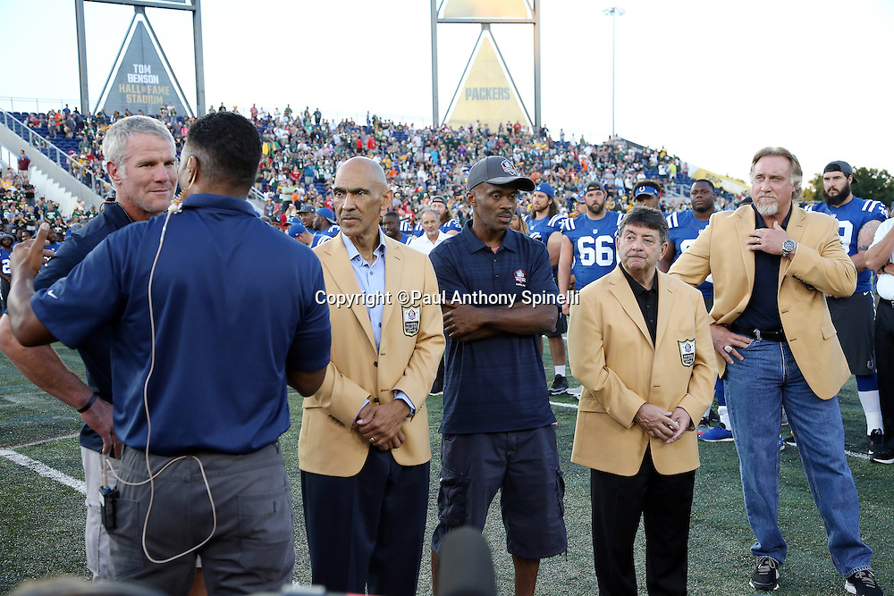 "(L-R) Former Green Bay Packers quarterback Brett Favre, former Indianapolis Colts head coach Tony Dungy, former Indianapolis Colts wide receiver Marvin Harrison, former San Francisco 49ers owner Edward J. ""Eddie"" DeBartolo Jr., and former NFL player and Green Bay Packers linebacker coach Kevin Greene are interviewed over the public address system as new members of the Pro Football Hall of Fame during the announcement canceling the game before the Green Bay Packers 2016 NFL Pro Football Hall of Fame preseason football game against the Indianapolis Colts on Sunday, Aug. 7, 2016 in Canton, Ohio. The game was canceled for player safety reasons due to the condition of the paint on the turf field. (©Paul Anthony Spinelli)"