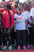 Margaret Kenyatta, the wife of the Kenyan President Uhuru Kenyatta with her entourage and other runners at the Green Start at The Virgin Money London Marathon 2014 on Sunday 13 April 2014<br />