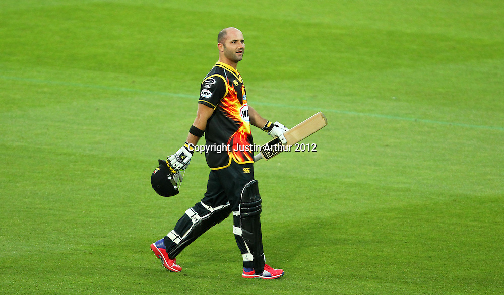 Firebirds' Luke Woodcock walks off the field after being dismissal during the 2012/2013 HRV Cup Twenty20 session. Wellington Firebirds v Auckland Aces at Westpac Stadium, Wellington, New Zealand on Friday 16 November 2012. Photo: Justin Arthur / photosport.co.nz