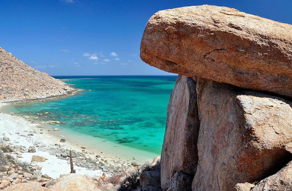 Boulders, Cardon cactus and beach, Isla Espiritu Santo, Sea of Cortez, Baja California, Mexico.