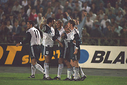 VLADIKAVKAZ, RUSSIA - Tuesday, September 12, 1995: Liverpool's Steve McManaman celebrates scoring the equalising goal against FC Alania Spartak Vladikavkaz with his team-mates Neil Ruddock, Steve Harkness and Stan Collymore during the UEFA Cup 1st Round 1st Leg match at Republican Spartak Stadium. (Photo by David Rawcliffe/Propaganda)