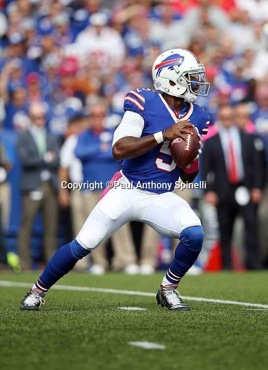 Buffalo Bills quarterback Tyrod Taylor (5) drops back to pass in the first quarter during the 2015 NFL week 4 regular season football game against the New York Giants on Sunday, Oct. 4, 2015 in Orchard Park, N.Y. The Giants won the game 24-10. (©Paul Anthony Spinelli)