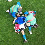 Medics treat an Italian player during the Ireland V Italy Pool C match during the IRB Rugby World Cup tournament. Otago Stadium, Dunedin, New Zealand, 2nd October 2011. Photo Tim Clayton...