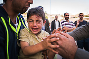 Hebron, West Bank - June 21, 2015: A Palestinian boy is hit by an Israeli car in the old city of Hebron.