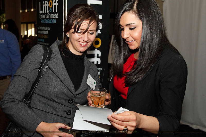 Shanon Potts of the City of Dayton (left) and Maha Kashani of DPL Energy Resources during the Better Business Bureau's Eclipse Integrity Awards dinner at Sinclair Community College's Ponitz Center in downtown Dayton, Tuesday, May 14 2013.