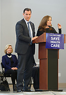 """Westbury, New York, USA. January 15, 2017. At podium, L-R, Representative THOMAS SUOZZI (Democrat - 3rd Congressional District NY) and Rep. KATHLEEN RICE (Democrat - 4th Congressional District) is speaking at the """"Our First Stand"""" Rally against Republicans repealing the Affordable Care Act, ACA, taking millions of people off health insurance, making massive cuts to Medicaid, and defunding Planned Parenthood. Hosts were Reps. T. Suozzi (Dem. - 3rd Congress. Dist.) and Rice."""