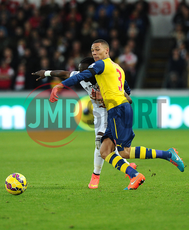 Arsenal's Kieran Gibbs battles for the ball with Swansea City's Marvin Emnes  - Photo mandatory by-line: Joe Meredith/JMP - Mobile: 07966 386802 - 09/11/2014 - SPORT - Football - Swanswa - Liberty Stadium - Swansea City v Arsenal - Barclays Premier League