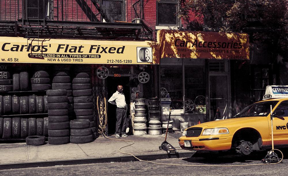 Man tired of fixing flats at Calos' flat fixed. NYC 2012