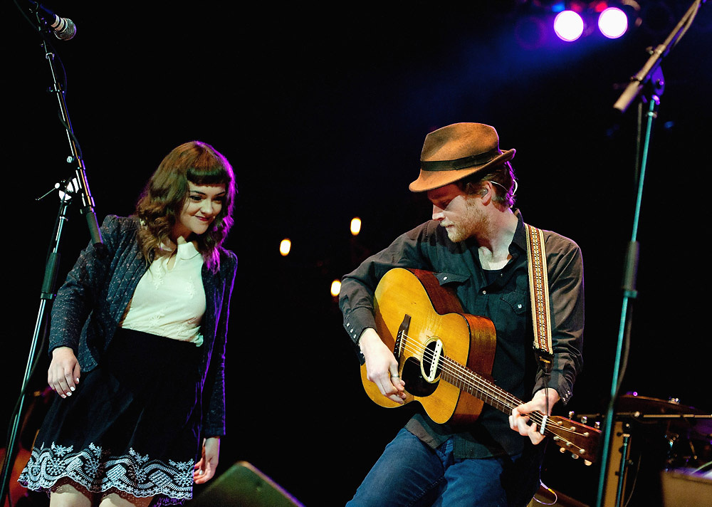 KANSAS CITY, KS - JUNE 01:  The Lumineers cellist Neyla Pekarek and lead singer Wesley Keith Schultz (R) perform during the Buzz Under The Stars concert at The Cricket Wireless Amphitheater on June 1, 2013 in Kansas City, Kansas.
