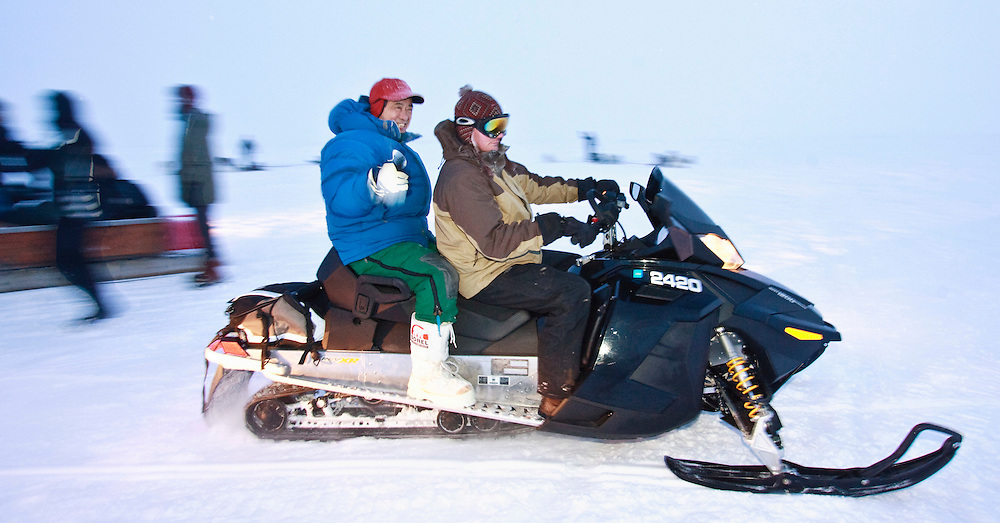 Japanese Finance Minister Naoto Kan rides a snowmobile on Frobisher Bay near Iqaluit, Canada as the G7 Finance Ministers wrap up their meetings, February 6, 2010. <br /> AFP/GEOFF ROBINS/STR