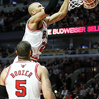 10 March 2012: Chicago Bulls forward Taj Gibson (22) dunks the ball during the Chicago Bulls 111-97 victory over the Utah Jazz at the United Center, Chicago, Illinois, USA.