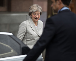 © Licensed to London News Pictures . 01/10/2017. Manchester, UK. Prime Minister THERESA MAY leaves the Midland Hotel to go to the BBC in Salford for the Marr Show . The Conservative Party Conference at the Manchester Central Convention Centre . Photo credit: Joel Goodman/LNP