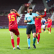 Refereee Sebastian Coltescu reaches for the red card as FYR Macedonia's Egzon Bejtulai shows his despair during Scotland Under-21 v FYR Macedonia,  UEFA Under 21 championship qualifier  at Tynecastle, Edinburgh. Photo: David Young<br /> <br />  - © David Young - www.davidyoungphoto.co.uk - email: davidyoungphoto@gmail.com
