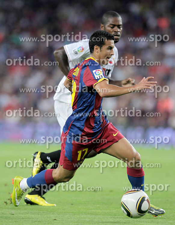 21.08.2010, Stadion Camp Nou, Barcelona, ESP, Supercup, FC Barcelona vs FC Sevilla, im Bild FC Barcelona's Pedro Rodriguez (f) and Sevilla's Christian Ndri Romaric during SuperCup of Spain Final match. EXPA Pictures © 2010, PhotoCredit: EXPA/ Alterphotos/ Acero +++++ ATTENTION - OUT OF SPAIN / ESP +++++ / SPORTIDA PHOTO AGENCY