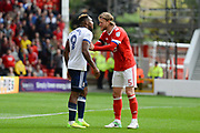 Nottingham Forest defender Matt Mills (5) speaks to Middlesbrough forward Britt Assombalonga (9) after a foul on Nottingham Forest goalkeeper Jordan Smith (43) during the EFL Sky Bet Championship match between Nottingham Forest and Middlesbrough at the City Ground, Nottingham, England on 19 August 2017. Photo by Jon Hobley.