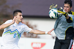 Maks Barisic of Slovenia vs Victor Silverio of Andorra during football game between Slovenia and Andorra of UEFA Under19 Championship Qualifications, on October 15, 2013 in Bakovci, Slovenia. (Photo by Erik Kavas / Sportida)