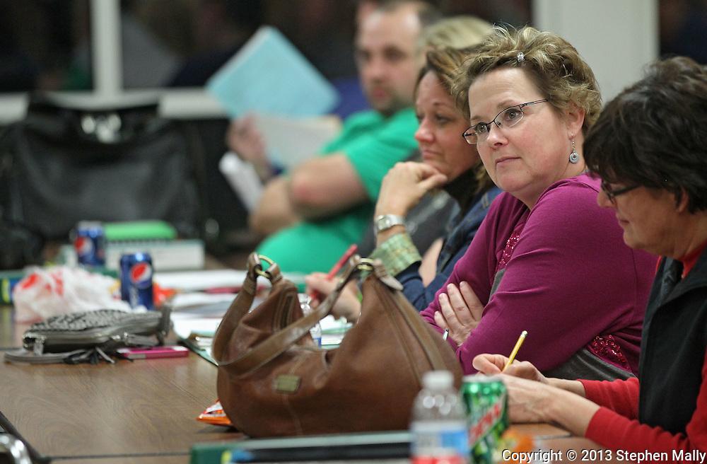 Lisa O'Donnell, 2nd grade teacher at Hiawatha Elementary School listens to a speaker at an Association Representation Assembly by the Cedar Rapids Education Association at Kennedy High School in Cedar Rapids on Wednesday evening, November 14, 2012.