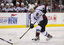 Mar 15; Newark, NJ, USA; Colorado Avalanche right wing Steve Downie (27) takes a shot during the first period of their game against the New Jersey Devils at the Prudential Center.