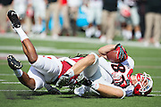 LITTLE ROCK, AR - OCTOBER 18:  Michael Bennett #82 of the Georgia Bulldogs is tackled during a game against the Arkansas Razorbacks at War Memorial Stadium on October 18, 2014 in Little Rock, Arkansas.  The Bulldogs defeated the Razorbacks 45-32.  (Photo by Wesley Hitt/Getty Images) *** Local Caption *** Michael Bennett