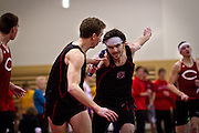 Sam Krauth '14, right, completes the baton hand-off to Noah Delong '11 for the last leg of the Men's 4x400m relay on Saturday.